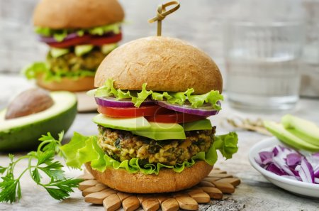 Photo for Spicy vegan curry burgers with millet, chickpeas and herbs. the toning. selective focus - Royalty Free Image