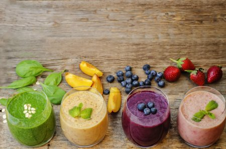 Photo for Smoothie with blueberries, peach, spinach and strawberries. the toning. selective focus - Royalty Free Image