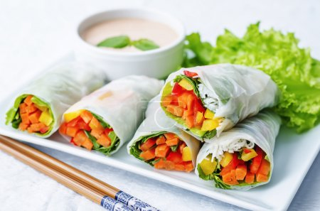 Photo for Spring rolls with chili mayonnaise dressing on a white background. the toning. selective focus - Royalty Free Image