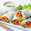 Spring rolls with chili mayonnaise dressing on a w...