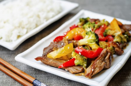 Photo for Pepper broccoli beef stir fry on a grey background. the toning. selective focus - Royalty Free Image