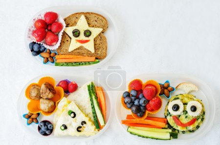 Photo for School lunch boxes for kids with food in the form of funny faces. the toning. selective focus - Royalty Free Image