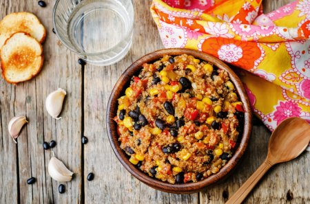 Photo for Black beans, quinoa and corn chili on a dark wood background. the toning. selective focus - Royalty Free Image