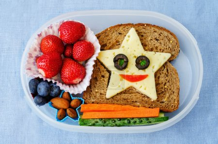 Photo for School lunch box for kids with food in the form of funny faces. the toning. selective focus - Royalty Free Image
