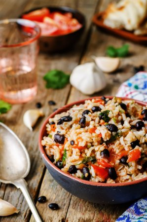 Photo for Mexican tomato black beans rice with cilantro. the toning. selective focus - Royalty Free Image