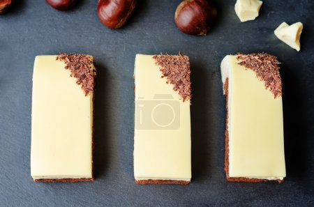 Photo for Chestnut brownie cake with chestnut  white chocolate mousse on a black background. toning. selective Focus - Royalty Free Image
