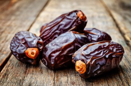 medjool dates on a dark wood background