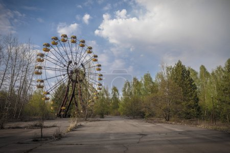 Photo for The abandoned Ferris wheel in the amusement park in Pripyat. Chernobyl nuclear power plant zone of alienatio - Royalty Free Image