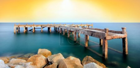 The old bridge over the sea with a beautiful sunrise, Rayong