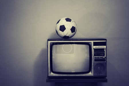 An old soccer ball on a retro TV, black and white