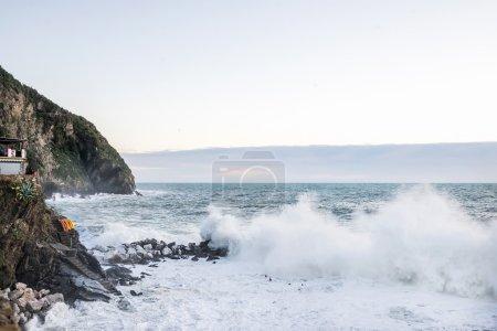 Big wave breaking over cliff