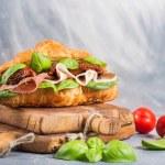 Постер, плакат: Croissant sandwich with smoked meat