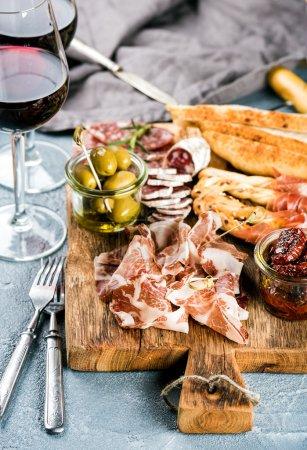 Meat appetizer selection. Salami, prosciutto, brea...