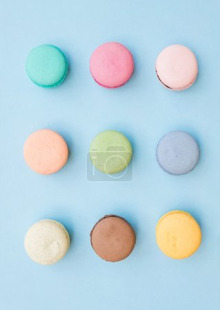 Photo for Sweet colorful French macaroon biscuits on pastel pink background, top view - Royalty Free Image