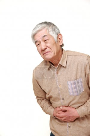 senior Japanese man suffers from stomachache