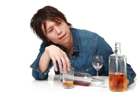 Photo pour Portrait de jeune Japonais sur fond blanc - image libre de droit