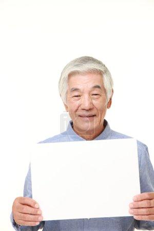 Photo for Portrait of senior Japanese man  wearing a blue shirts on white background - Royalty Free Image