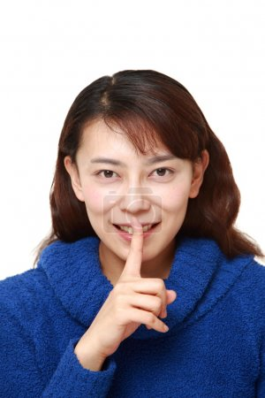 Asian woman whith silence gestures