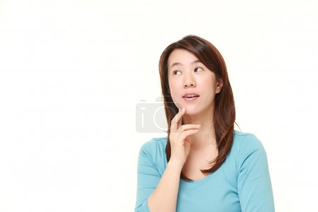 Middle aged Japanese woman thinks about something