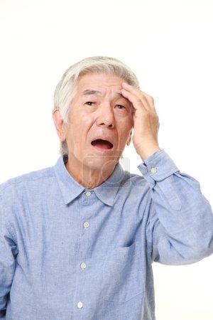 Photo for Studio shot of senior Japanese man in a blue shirts on white background - Royalty Free Image