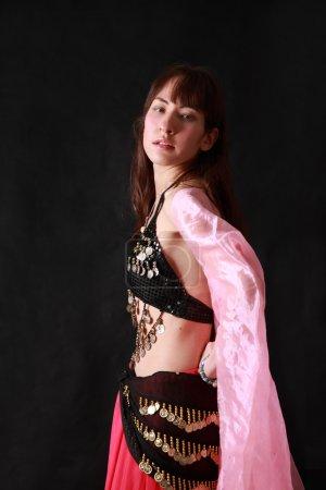 Belly dancer on black background