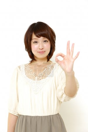 Japanese woman showing perfect sign