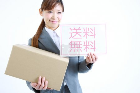 Businesswoman showing a card with word  Free shipping in Japanese Kanji