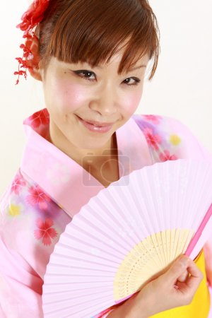 Young woman with paper Fan?