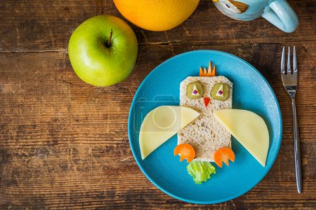 Healthy lunch for kids, funny sandwich and fruits