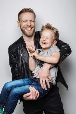 Photo for Young father and son laughing together. Fathers day.  Studio portrait over white background - Royalty Free Image