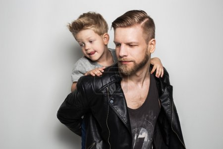 Photo for Portrait of young attractive smiling father playing with his little cute son. Fathers day.  Studio portrait over white background - Royalty Free Image