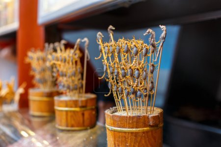 Chinese food. Scorpions on a stick.