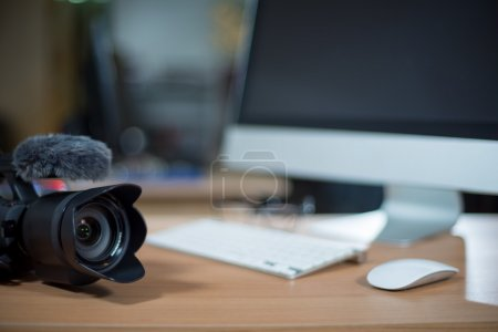 Video editing workstation with video camera beside