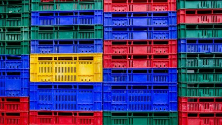 many colors stack of plastic crates background
