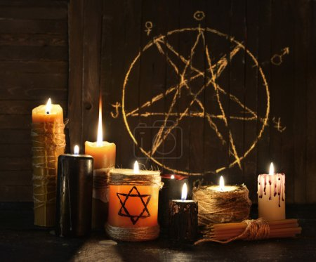 Photo for Still life with burning candles against pentagram circle background. Black magic ritual with occult, evil and esoteric symbols. Halloween or divination rite - Royalty Free Image