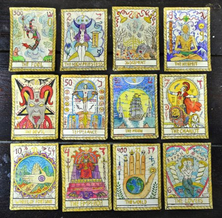 Photo for Background with the tarot cards, top view. The major arcana deck. Fortune telling seance or black magic ritual. Scary still life with occult and esoteric symbols. Halloween or divination rite - Royalty Free Image