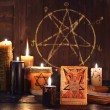 Magic or Halloween still life with evil candles an...