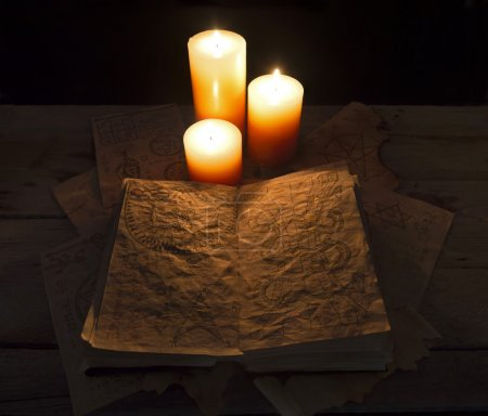 Magic book in candles light