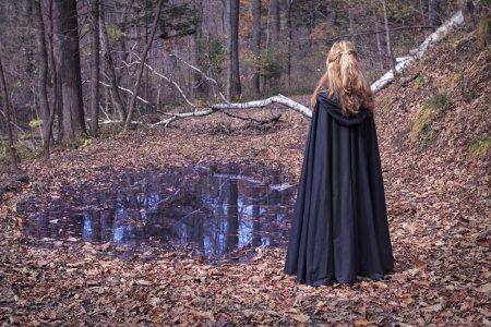 blonde girl wearing black mantle