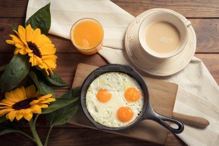 Breakfast: coffee, eggs and orange juice