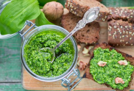 Photo for Ramson, wild garlic and sauce pesto on a wooden table - Royalty Free Image