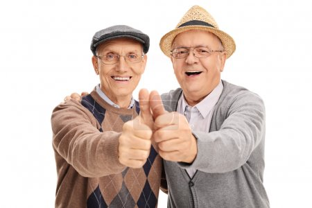 Two old friends giving thumbs up