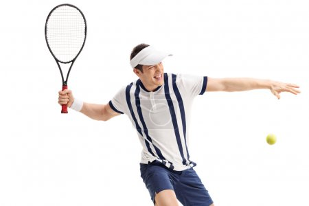 Young tennis player hitting a return
