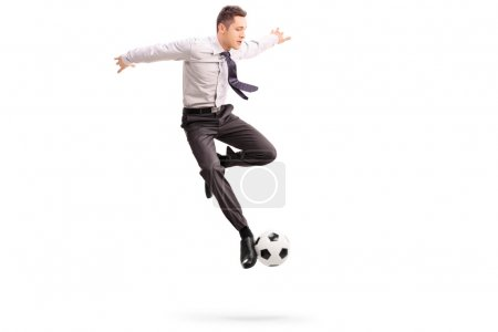 Young businessman playing football
