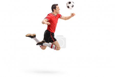 Football player heading a ball