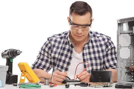 PC technician measuring electrical resistance