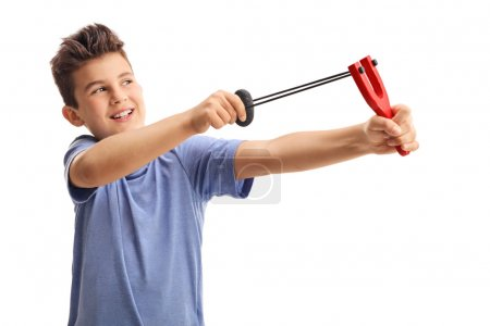 Cheerful kid shooting with a slingshot