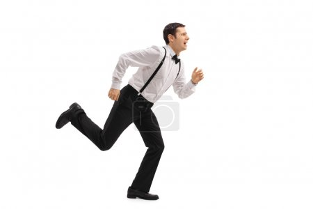Well-dressed man running