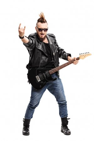 Punk guitarist making a rock sign