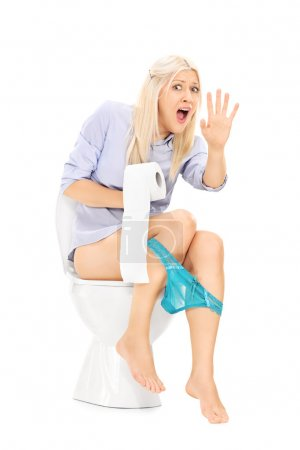 Interrupted girl sitting on toilet